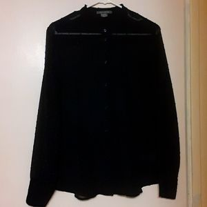 Black sheer blouse with dark blue accents.